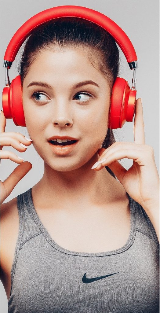 Image of woman wearing Havit i18 headphones