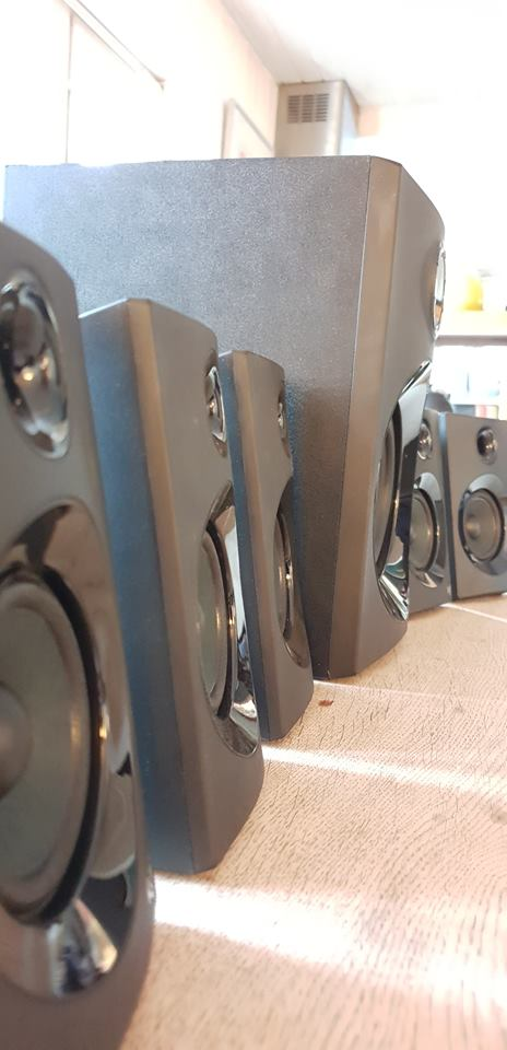 Image of 5 speakers and a subwoofer